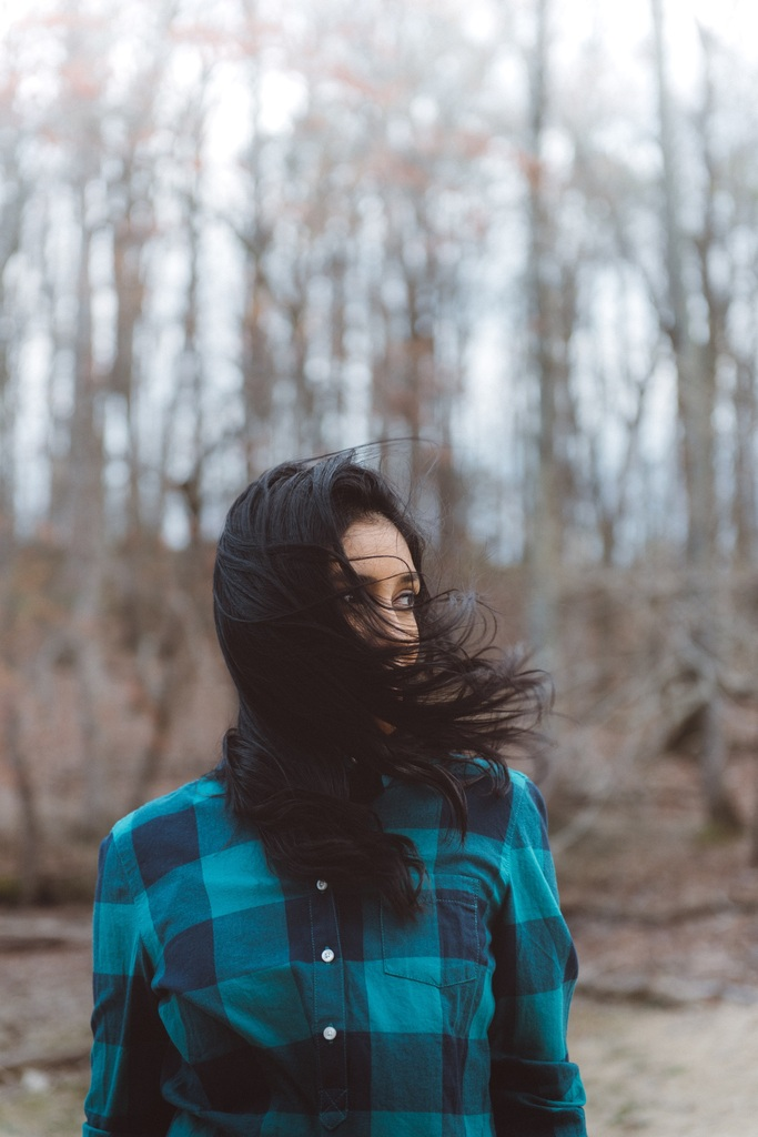 woman outside with wind blowing through her hair