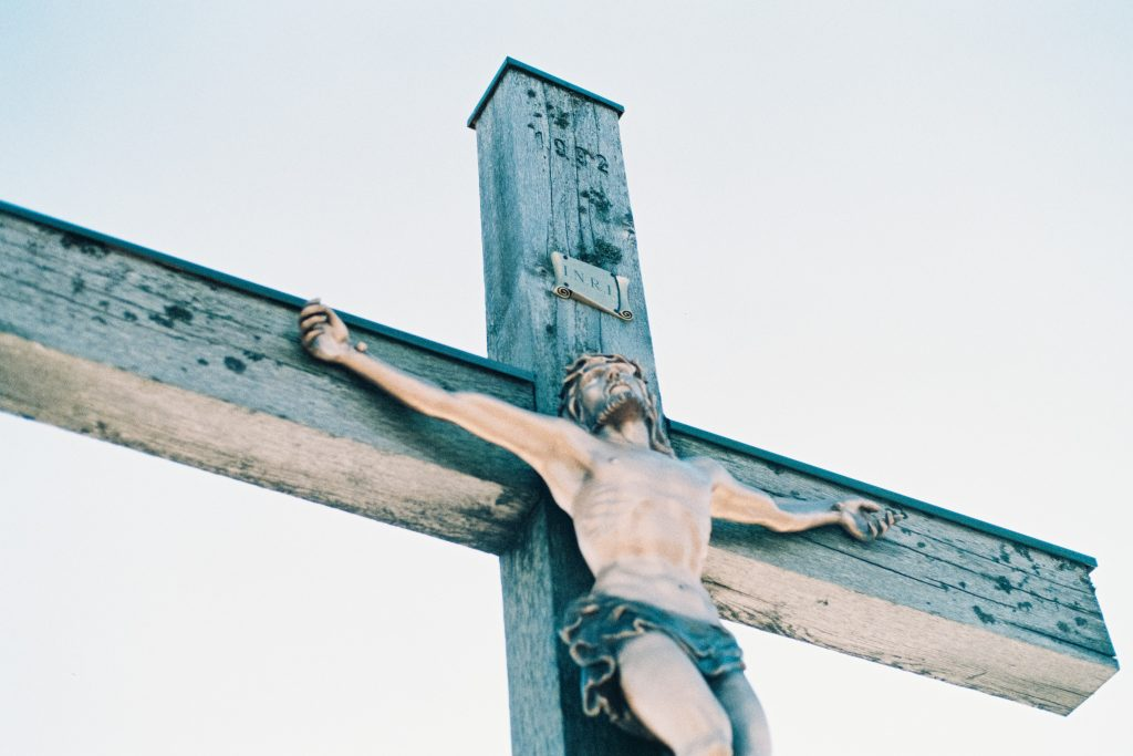 """Jesus on a cross, the sign """"King of the Jews"""" hung above his head. For the purpose of the story of Thomas doubting the resurrection, because this death was final."""